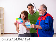 Купить «Young couple and old contractor in home renovation concept», фото № 34047194, снято 2 сентября 2019 г. (c) Elnur / Фотобанк Лори