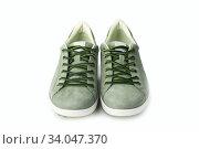 Купить «Men's green nubuck leather sneakers, leather lace, fabric lining and light platform soles», фото № 34047370, снято 15 января 2017 г. (c) Nataliia Zhekova / Фотобанк Лори