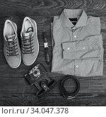 Купить «Flat lay of modern men's clothing on a brown wooden background.», фото № 34047378, снято 15 января 2017 г. (c) Nataliia Zhekova / Фотобанк Лори