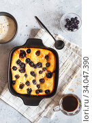 Cottage cheese casserole baked with blueberry. Curd casserole with fresh berries on kitchen table. Стоковое фото, фотограф Nataliia Zhekova / Фотобанк Лори