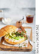 Healthy sandwich with bread, fresh avocado and cheese garnished with radish microgreens. Healthy eating concept. Avocado, ricotta cheese and radish sprouts. Стоковое фото, фотограф Nataliia Zhekova / Фотобанк Лори
