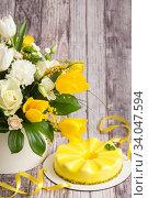 Купить «Gift set - yellow mousse cake and a large Spring medley bouquet of beautiful flowers. Valentine's Day. Happy Mother's day», фото № 34047594, снято 25 февраля 2020 г. (c) Nataliia Zhekova / Фотобанк Лори