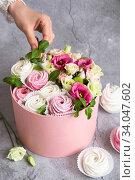 Купить «Gift set in the box - white and pink marshmallows and beautiful flowers on the grey grunge background. Valentine's Day. Happy Mother's Day.», фото № 34047602, снято 25 февраля 2020 г. (c) Nataliia Zhekova / Фотобанк Лори
