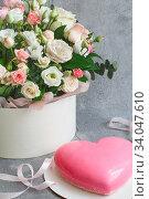 Купить «Gift set - pink heart-shaped mousse cake and a large bouquet of beautiful flowers on the grey grunge background. Valentine's Day. Mothers Day», фото № 34047610, снято 1 февраля 2020 г. (c) Nataliia Zhekova / Фотобанк Лори