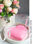 Gift set - pink heart-shaped mousse cake and a large bouquet of beautiful flowers on the grey grunge background. Valentine's Day. Mothers Day. Стоковое фото, фотограф Nataliia Zhekova / Фотобанк Лори