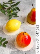 Купить «Mousse dessert in the shape of a pear fruit, orange fruit, apricot, lemon and cherry.», фото № 34047622, снято 1 февраля 2020 г. (c) Nataliia Zhekova / Фотобанк Лори