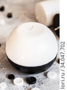 Купить «Decorative Handmade sphere and cylinder shape candles. Big black and white gift candles», фото № 34047702, снято 16 января 2020 г. (c) Nataliia Zhekova / Фотобанк Лори