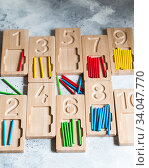 Купить «Wooden counting and writing trays - learning resource for educating littles on number writing, fine motor skills, hand eye coordination, mathematical skills. Montessori materials. Counting game», фото № 34047770, снято 6 мая 2020 г. (c) Nataliia Zhekova / Фотобанк Лори