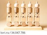 Купить «Children's wooden toys. Sequencing education Blocks, motor skills», фото № 34047786, снято 2 июня 2020 г. (c) Nataliia Zhekova / Фотобанк Лори