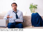 Купить «Young male employee working from house», фото № 34047858, снято 30 октября 2019 г. (c) Elnur / Фотобанк Лори