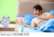 Man having trouble with his sleep. Стоковое фото, фотограф Elnur / Фотобанк Лори
