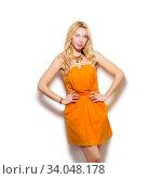 Купить «Fashion model girl portrait in orange short dress and modern accessories», фото № 34048178, снято 13 марта 2016 г. (c) Nataliia Zhekova / Фотобанк Лори