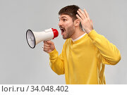 angry man shouting to megaphone. Стоковое фото, фотограф Syda Productions / Фотобанк Лори