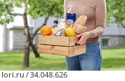 close up of woman with food in wooden box. Стоковое фото, фотограф Syda Productions / Фотобанк Лори