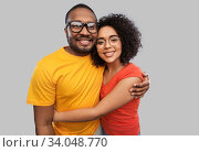 Купить «happy african american couple in glasses hugging», фото № 34048770, снято 15 декабря 2019 г. (c) Syda Productions / Фотобанк Лори
