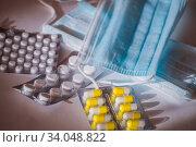 Купить «Medical masks and pharmaceutical preparations in blisters. Virus protection during a  covid-19 epidemic», фото № 34048822, снято 24 марта 2020 г. (c) irisff / Фотобанк Лори