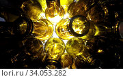 Top view in production line. Empty brown beer bottles, the top view on a white background. Empty bottles. Slider shot of empty glass bottles. Shot in 4K UHD. Стоковое видео, видеограф Куликов Константин / Фотобанк Лори
