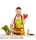 Купить «Beautiful sexy young woman cooking fresh meal against white background. Woman cuts vegetables for salad.», фото № 34053434, снято 18 мая 2015 г. (c) Nataliia Zhekova / Фотобанк Лори