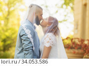 Купить «Just married loving hipster couple in wedding dress and suit in the park. Happy bride and groom walking running and dancing. Romantic Married young family.», фото № 34053586, снято 5 октября 2018 г. (c) Nataliia Zhekova / Фотобанк Лори