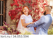 Just married loving hipster couple in wedding dress and suit in the park. Happy bride and groom walking running and dancing. Romantic Married young family. Стоковое фото, фотограф Nataliia Zhekova / Фотобанк Лори