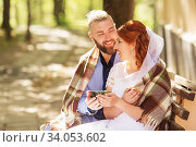 Купить «Just married loving hipster couple in wedding dress and suit in the park. Happy bride and groom walking running and dancing. Romantic Married young family.», фото № 34053602, снято 5 октября 2018 г. (c) Nataliia Zhekova / Фотобанк Лори