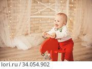 lovely little baby boy riding rocking deer. Стоковое фото, фотограф Nataliia Zhekova / Фотобанк Лори