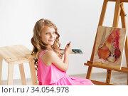 Купить «Portrait of a lovely little girl painting a picture in a studio or art school», фото № 34054978, снято 15 мая 2016 г. (c) Nataliia Zhekova / Фотобанк Лори