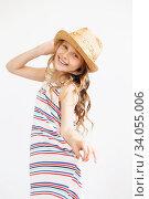 Купить «Lovely little girl with straw hat against a white background», фото № 34055006, снято 15 мая 2016 г. (c) Nataliia Zhekova / Фотобанк Лори