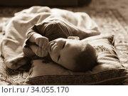 Купить «Happy laughing baby lying on a bed», фото № 34055170, снято 15 февраля 2014 г. (c) Nataliia Zhekova / Фотобанк Лори
