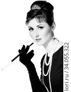 Portrait of a beautiful young woman in retro style with cigarette in mouthpiece in the image of the famous actress. Стоковое фото, фотограф Nataliia Zhekova / Фотобанк Лори