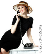Купить «Portrait of a beautiful brown-eyed woman in a hat with a vintage telephone», фото № 34055342, снято 28 апреля 2014 г. (c) Nataliia Zhekova / Фотобанк Лори