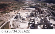 Купить «View from drone of cement plant industrial area, Bunol, Spain», видеоролик № 34055622, снято 24 апреля 2019 г. (c) Яков Филимонов / Фотобанк Лори