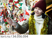 female teen near counter with Christmas gifts. Стоковое фото, фотограф Яков Филимонов / Фотобанк Лори