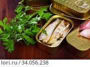 Купить «Natural mackerel fillets in open tin can and fresh parsley on wooden table», фото № 34056238, снято 4 августа 2020 г. (c) Яков Филимонов / Фотобанк Лори