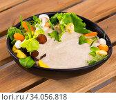 Mushroom creamy soup with shitake, served with vegetables and greens. Стоковое фото, фотограф Яков Филимонов / Фотобанк Лори