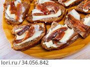 Купить «Bread with butter and salted anchovy fillets», фото № 34056842, снято 4 августа 2020 г. (c) Яков Филимонов / Фотобанк Лори