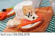 Купить «Canape with cambozola cheese and salmon», фото № 34056878, снято 11 июля 2020 г. (c) Яков Филимонов / Фотобанк Лори