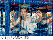 Купить «Girl behind the grid in the game maze, playground», фото № 34057186, снято 10 марта 2020 г. (c) Tryapitsyn Sergiy / Фотобанк Лори