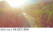 Купить «Low altitude flight over fresh fast mountain river with rocks at sunny summer morning.», видеоролик № 34057494, снято 7 апреля 2019 г. (c) Александр Маркин / Фотобанк Лори