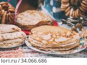 Купить «The dishes of the traditional Belarusian cuisine - pancakes. Attribute of traditional folk celebration of Maslenitsa.», фото № 34066686, снято 12 марта 2016 г. (c) easy Fotostock / Фотобанк Лори
