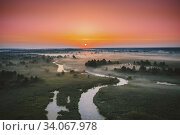 Купить «Aerial View Green Meadow And River Landscape In Misty Foggy Morning. Top View Of Beautiful European Nature From High Attitude In Summer Season. Drone View. Bird's Eye View.», фото № 34067978, снято 28 мая 2019 г. (c) easy Fotostock / Фотобанк Лори