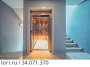 Elevator with open doors and stairs up and down. Стоковое фото, фотограф Ольга Сапегина / Фотобанк Лори