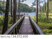 Wooden pier on Suchar Wielki Lake in the area of Wigry National Park near Slupie village within Suwalki County, Podlaskie Voivodeship in Poland. (2019 год). Редакционное фото, фотограф Konrad Zelazowski / age Fotostock / Фотобанк Лори
