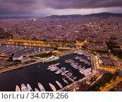 Купить «Aerial view of old port in Barcelona and historical part of the city at night», фото № 34079266, снято 1 сентября 2018 г. (c) Яков Филимонов / Фотобанк Лори