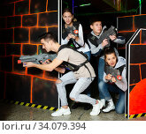 Excited young people during lasertag game. Стоковое фото, фотограф Яков Филимонов / Фотобанк Лори