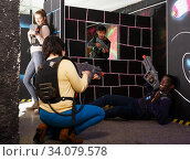 group of adult people with laser guns having fun. Стоковое фото, фотограф Яков Филимонов / Фотобанк Лори