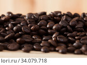 Coffee beans on light wooden background. Стоковое фото, фотограф Яков Филимонов / Фотобанк Лори