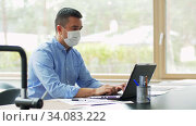 man in mask with laptop working at home office. Стоковое видео, видеограф Syda Productions / Фотобанк Лори