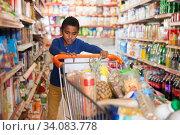 Купить «African boy shopping in grocery», фото № 34083778, снято 15 апреля 2019 г. (c) Яков Филимонов / Фотобанк Лори