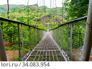 Suspension swinging bridge over the gorge in Armenia near the cave city Khndzoresk. Стоковое фото, фотограф Константин Лабунский / Фотобанк Лори
